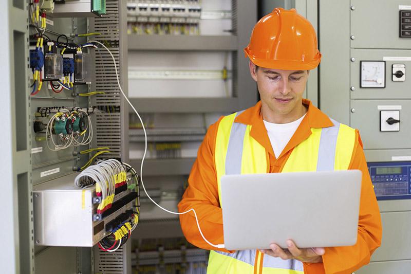 technician checking machine status
